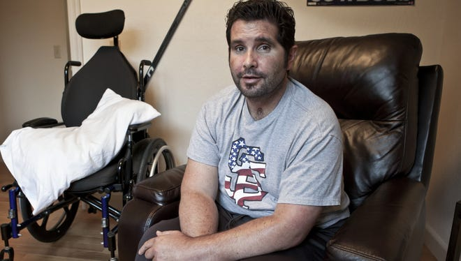 """Bryan Stow, 44, sits Tuesday in his bedroom at his parents' house in Capitola, Calif. """"If you ask Bryan what his career is, he is still a paramedic in his head,"""" says his mother, Ann. """"But he will not be a paramedic again. Bryan has holes in his memory."""""""