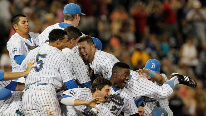 UCLA Bruins celebrate after Game 2 of the College World Series finals against the Mississippi State Bulldogs at TD Ameritrade Park. UCLA defeated Mississippi State 8-0.