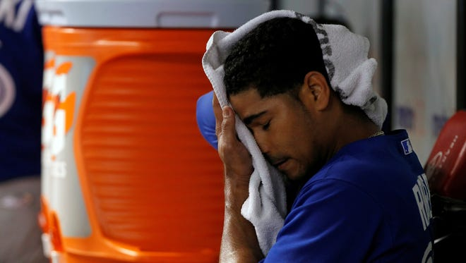 Toronto Blue Jays pitcher Esmil Rogers (32) reacts in the dugout after he pitched the second inning against the Tampa Bay Rays at Tropicana Field.