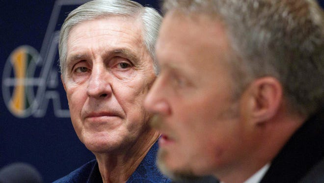 In this Feb. 10, 2011, file photo, then-Utah Jazz coach Jerry Sloan, left, listens to Jazz president Greg Miller during a news conference in Salt Lake City, at the announcement that Sloan was resigning immediately. Jazz CEO Miller says he pleaded with Sloan not to quit mid-season two years ago, but that the longtime coach couldn't be talked out of it.