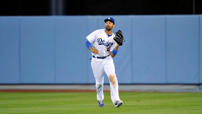 Los Angeles Dodgers center fielder Matt Kemp (27) catches a fly ball during the ninth inning against the San Francisco Giants at Dodger Stadium.