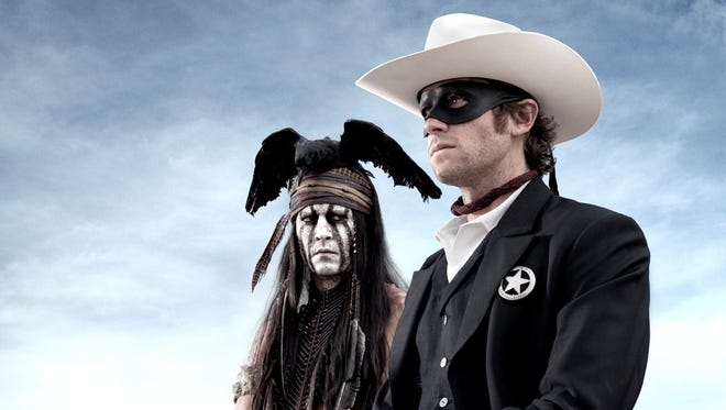 Johnny Depp, left, as Tonto joins forces in a fight for justice with Armie Hammer, as John Reid, a lawman who has become a masked avenger, The Lone Ranger, from the movie, 'The Lone Ranger,' opening July 3.