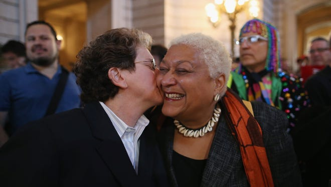 A couple celebrates upon hearing the U.S. Supreme Court has struck down the Defense of Marriage Act at City Hall on June 26 in San Francisco.