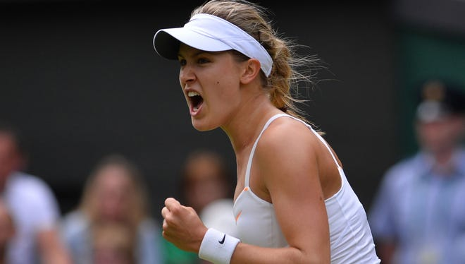 Canada's Eugenie Bouchard celebrates beating Serbia's Ana Ivanovic during their women's second round match on day three of the 2013 Wimbledon Championships.