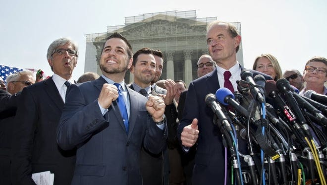 Plaintiffs in the California Proposition 8 case celebrates the Supreme Court ruling Wednesday.