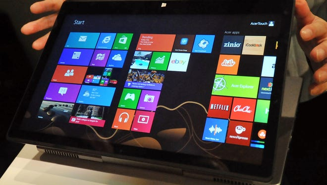 A new notebook by Taiwan's Acer, called the Aspire R7, running Windows 8, is displayed during a press conference ahead of the opening of the Computex trade fair in Taipei.