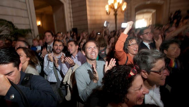 Gay rights activists celebrate Wednesday at San Francisco's City Hall.