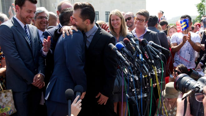 Jeff Zarrillo, Paul Katami, Sandy Stier and Kris Perry, challengers to California's same-sex marriage ban celebrate after speaking to the media in front of the Supreme Court building Wednesday after the Justices ruled on two same-sex marriage cases.