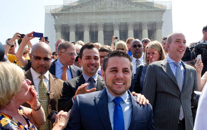 Challengers to California's same-sex marriage ban Jeff Zarrillo and his partner Paul Katami walk from the Supreme Court building to talk to the media after the court announced their decision on June 26.
