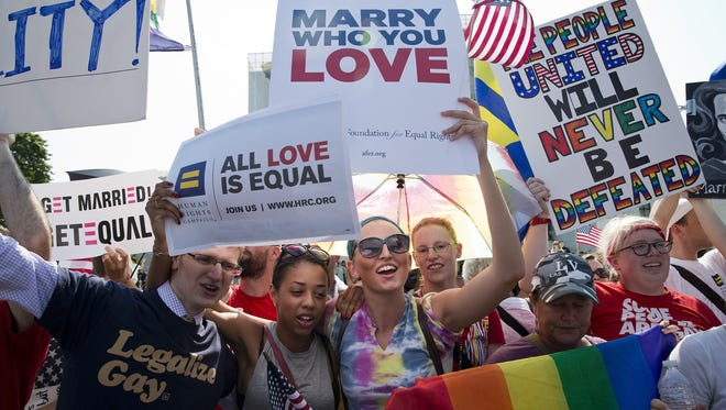 Supporters of gay marriage celebrate after the U.S. Supreme Court overturned the Defense of Marriage Act and declined to rule on the California law Proposition 8 in Washington, D.C., U.S. on Wednesday, June 26, 2013.