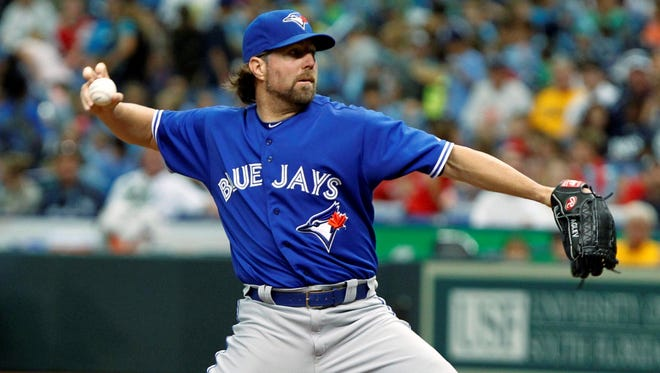 R.A. Dickey (7-8) retired his first 13 batters before James Loney grounded a single between shortstop and third base with one out in the fifth.