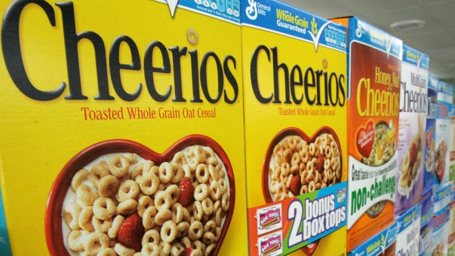 Boxes of General Mills' Cheerios breakfast cereal varieties are displayed at a Little Rock, Ark., grocery store.
