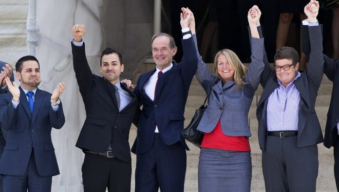 Plaintiffs in Hollingsworth v. Perry celebrate Wednesday at the Supreme Court.