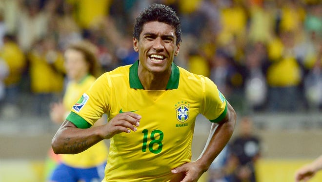 Paulinho celebrates his game-winning goal in the 86th minute.