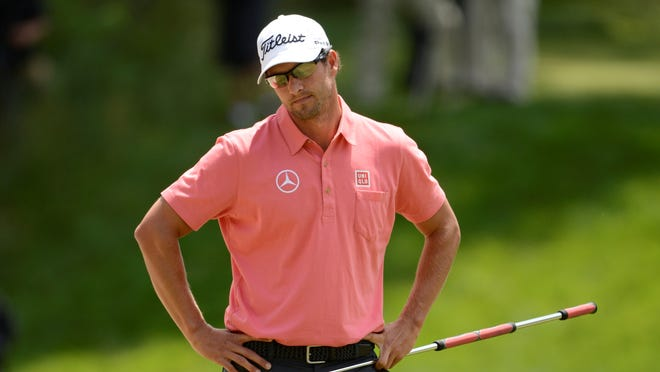 Adam Scott reacts after putting on the 17th green during the second round of the 113th U.S. Open golf tournament at Merion Golf Club.