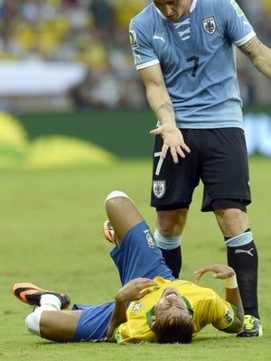 Uruguay midfielder Cristian Rodriguez (7) gestures at Brazil striker Neymar during their Confederations Cup semifinal.