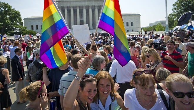 Gay marriage supporters celebrate at the Supreme Court on Wednesday.
