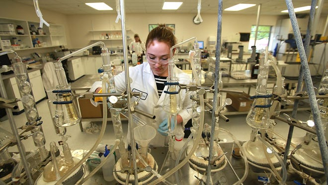 Abby Diehl of Des Moines works in the lab on Tuesday during a tour of Eurofins, which will open its doors to the public on Thursday as part of a celebration of 25 years in Des Moines.