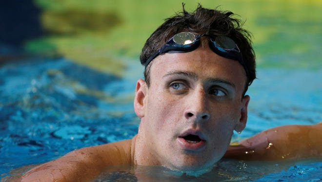 Ryan Lochte looks up at the scoreboard after winning the men's 200-meter backstroke during the U.S. National Championships Wednesday in Indianapolis.