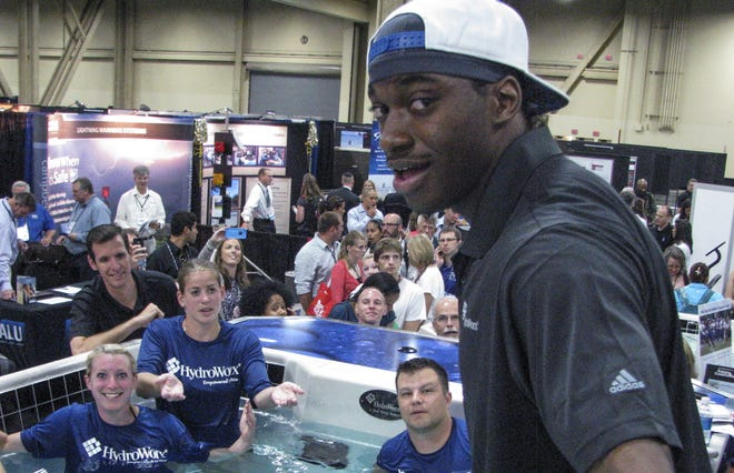 Washington Redskins quarterback Robert Griffin III  in Las Vegas on  Wednesday at the athletic trainer's? convention to promote the underwater treadmill system, HydroWorx, he has used in rehabbing from knee surgery.