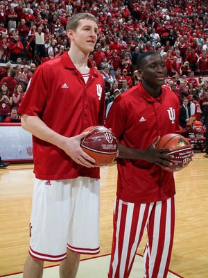 Indiana Hoosiers from left to right Cody Zeller and Victor Oladipo are awarded balls for scoring over a 1,000 points during their career before the game against the Ohio State Buckeyes at Assembly Hall.