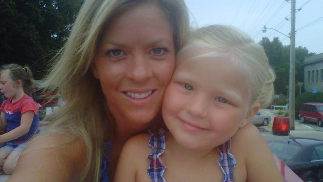 Melissa Nelson, pictured with her daughter, will get a second chance with her claim that the dentist she worked for fired her because he was attracted to her now that the Iowa Supreme Court has agreed to reconsider her case.