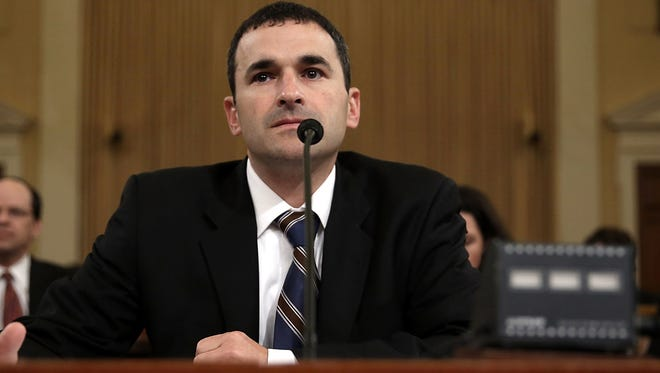 Acting Internal Revenue Service Commissioner Danny Werfel testifies during a hearing before the House Ways and Means Committee on Thursday.