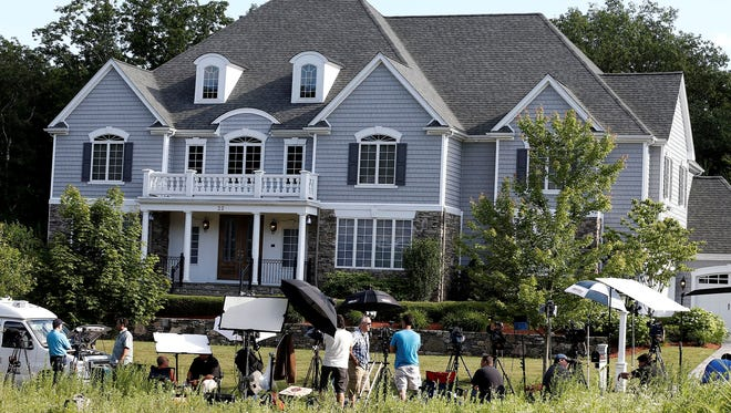Members of the media stake out the house of former New England Patriots tight end Aaron Hernandez in North Attleborough, Mass.
