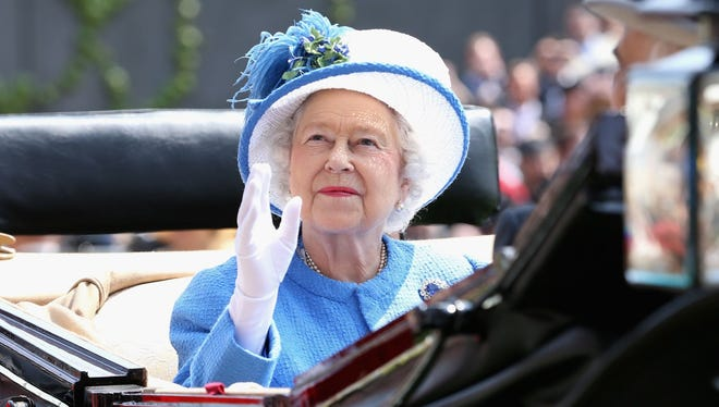 Queen Elizabeth II waves as she arrives during the Royal Procession on day four of Royal Ascot at Ascot Racecourse on June 21, 2013.