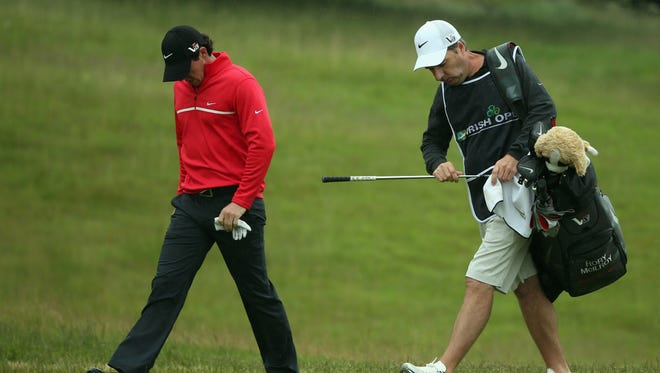 Rory McIlroy of Northern Ireland and his caddie JP Fitzgerald look dejected during the first round of the Irish Open on Thursday.
