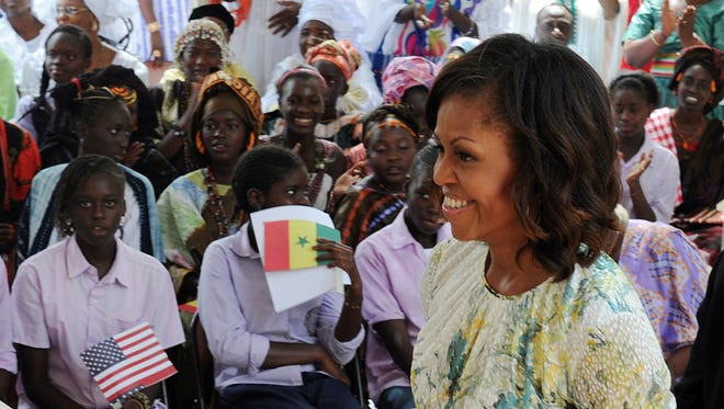 First lady Michelle Obama smiles during a visit to the Martin Luther King school on June 27, 2013, in Dakar, Senegal.