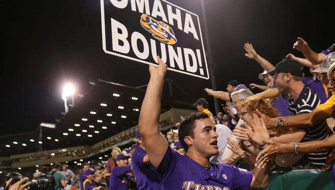 Catcher Chris Chinea celebrates with LSU fans after the team clinched a spot in this year's College World Series. The Tigers have topped Division I baseball in total attendance each of the last 18 seasons.