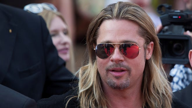"""Brad Pitt walks on the red carpet prior the """"World War Z"""" premiere in Moscow."""