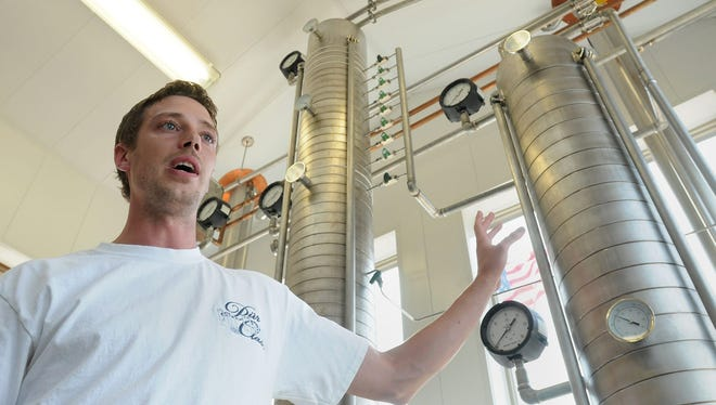 Karl Hendricks discusses the vodka distilling process in front of custom-made stills he designed at the Hendricks Family Distillery in Eureka, Wis., on Sunday, June 23, 2013.