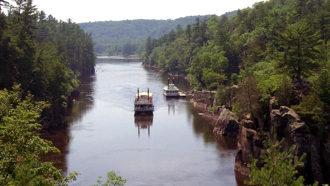 Paddle boats offer scenic trips through the narrow rocky gorge known as the Dalles of the St. Croix River in Minnesota.