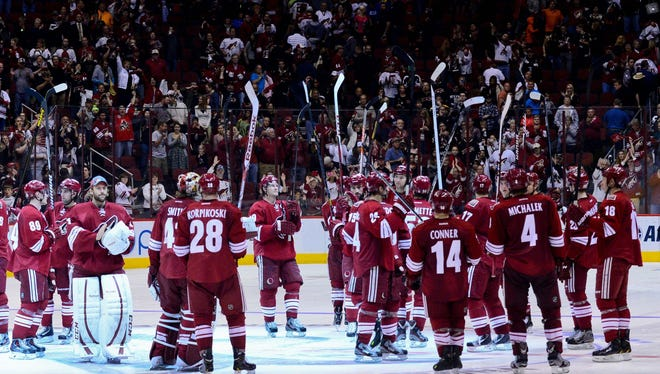 Phoenix Coyotes players salute the crowd after their season home finale in April.