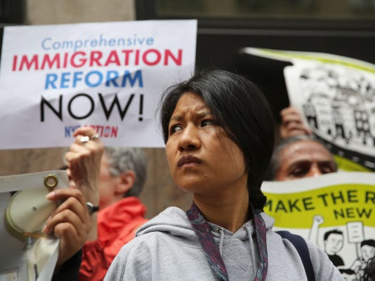 Senate passes sweeping rewrite of immigration laws