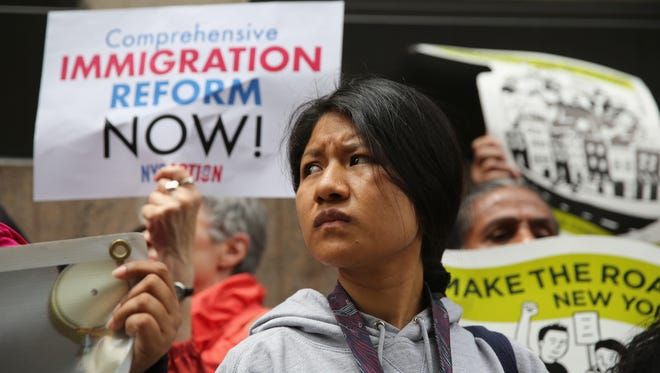 Immigration advocates demonstrate outside a detention facility run by Immigration and Customs Enforcement (ICE) on June 14.