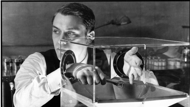 """Jude Law in a scene from the 1997 film """"Gattaca,"""" in which genes determine social class. DNA databases are growing in real life."""