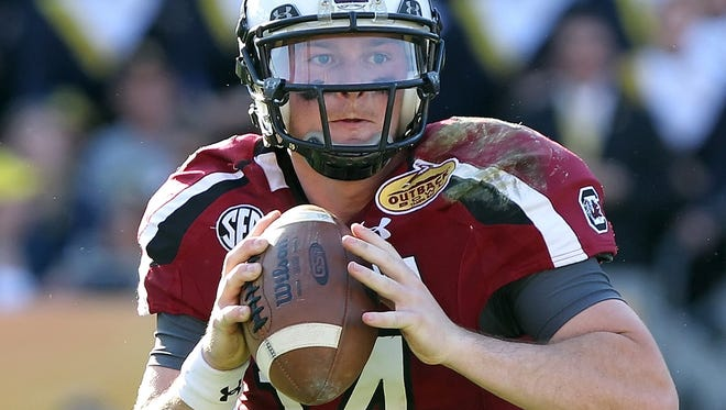 South Carolina quarterback Connor Shaw runs out of the pocket against Michigan during the second half of the 2013 Outback Bowl in Tampa. Shaw is back to health after a shoulder injury and offseason ankle surgery.