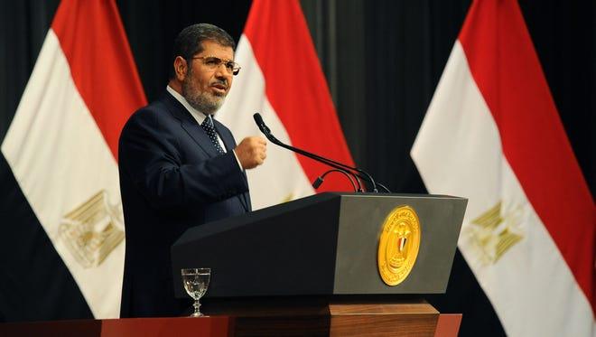 Egyptian President Mohammed Morsi delivers a speech, in Cairo, Egypt, June 26.