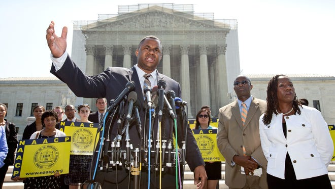 Ryan P. Haygood, director of the NAACP Legal Defense Fund, talks outside the Supreme Court in Washington.