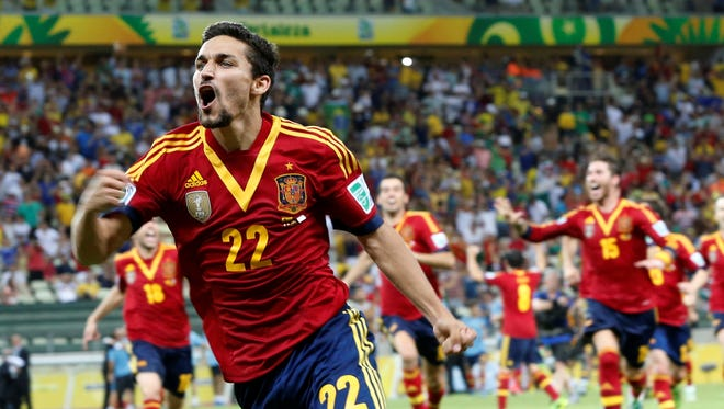 Spain's Jesus Navas celebrates after scoring the winning penalty against Italy during the  Confederations Cup semifinal match at the Castelao stadium in Fortaleza, Brazil, Thursday.