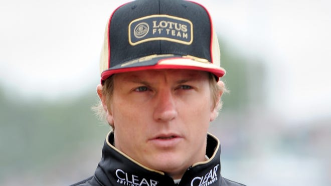 Lotus driver Kimi Raikkonen of Finland walks through the pits before practice session 3 at the Canadian Formula One Grand Prix on June 8, 2013.
