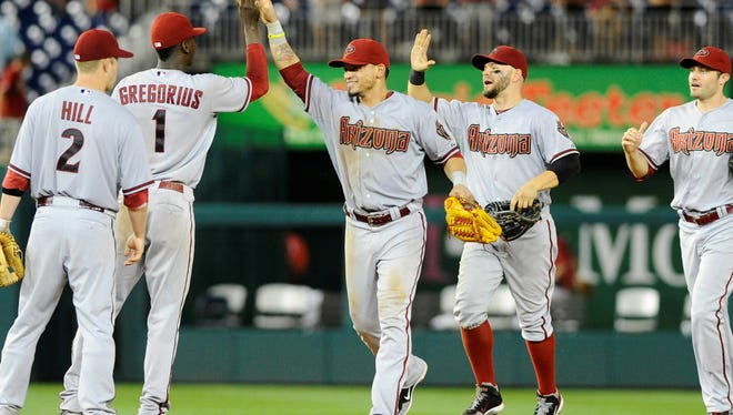 Arizona Diamondbacks players celebrate after recording the final out after the 11th inning against the Washington Nationals at Nationals Park.