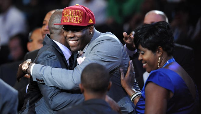 Anthony Bennett from UNLV gets a hug from family members after being selected as the first overall pick to the Cleveland Cavaliers in the 2013 NBA Draft. Bennett and his 2013 draft class peers are in the midst of countless major changes in their lives.