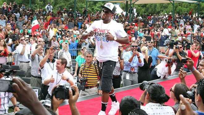 Floyd Mayweather struts his stuff in Atlanta during their tour stop there on Thursday. He called Atlanta like his second home.