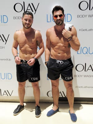 Valentin Chmerkovskiy (left) and his brother Maks arrive with their six packs at the Liquid Pool Lounge at the Aria Resort , Casino at CityCenter on Thursday.