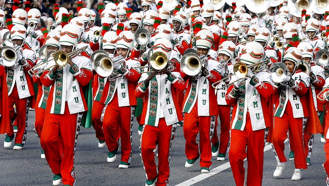 The Florida A,M Marching 100 band, shown here performing Tuesday Jan., 4, 2011, in Gov. Rick Scott's inaugural parade, was suspended in November 2011 following the hazing death of drum major Robert Champion.