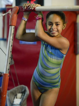 Lea Lewis Lepiarz, 10, was flipping around the higher of the uneven parallel bars when her fingers slipped. After she crashed to the ground, she had a concussion.